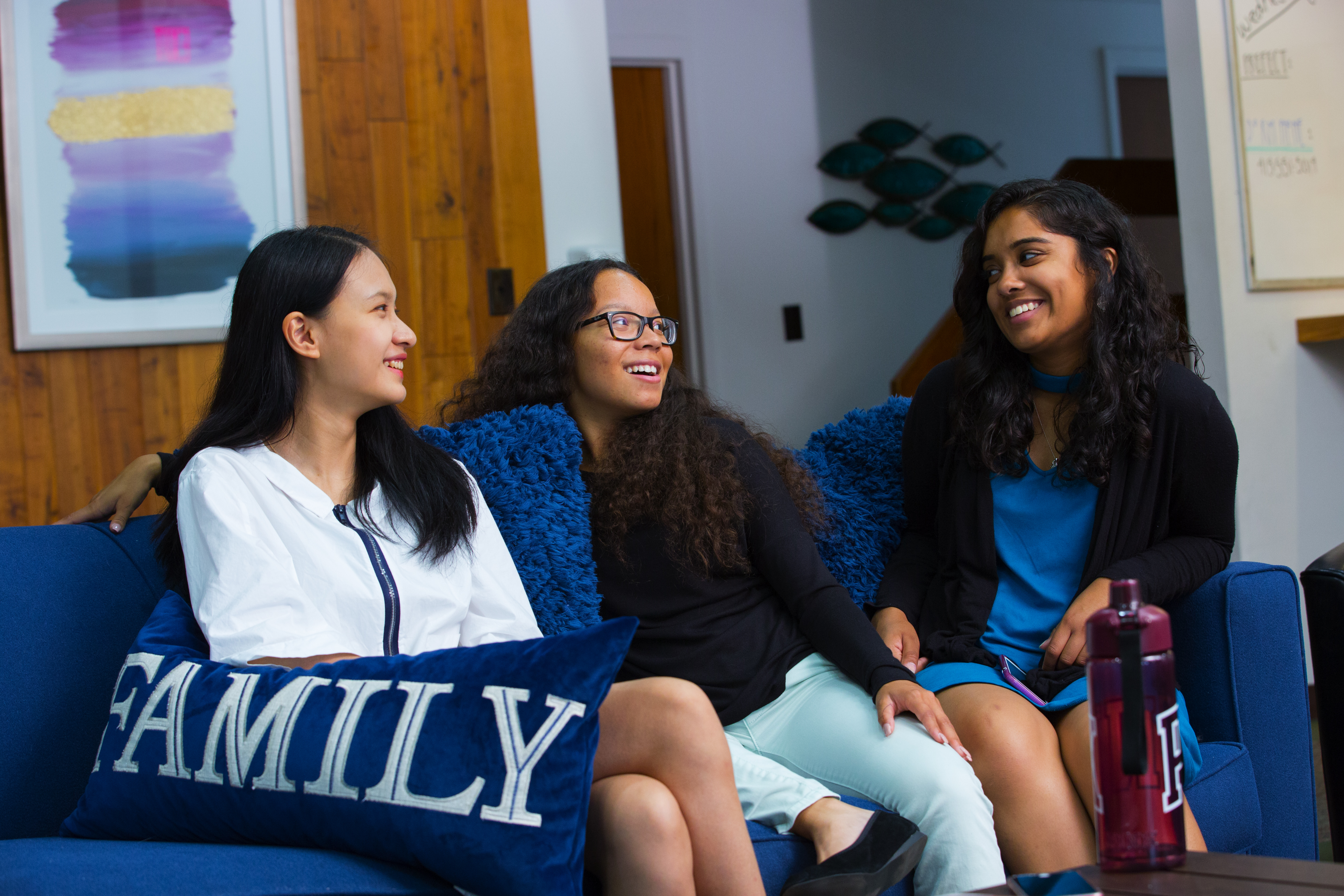 Boarding students talking on a couch