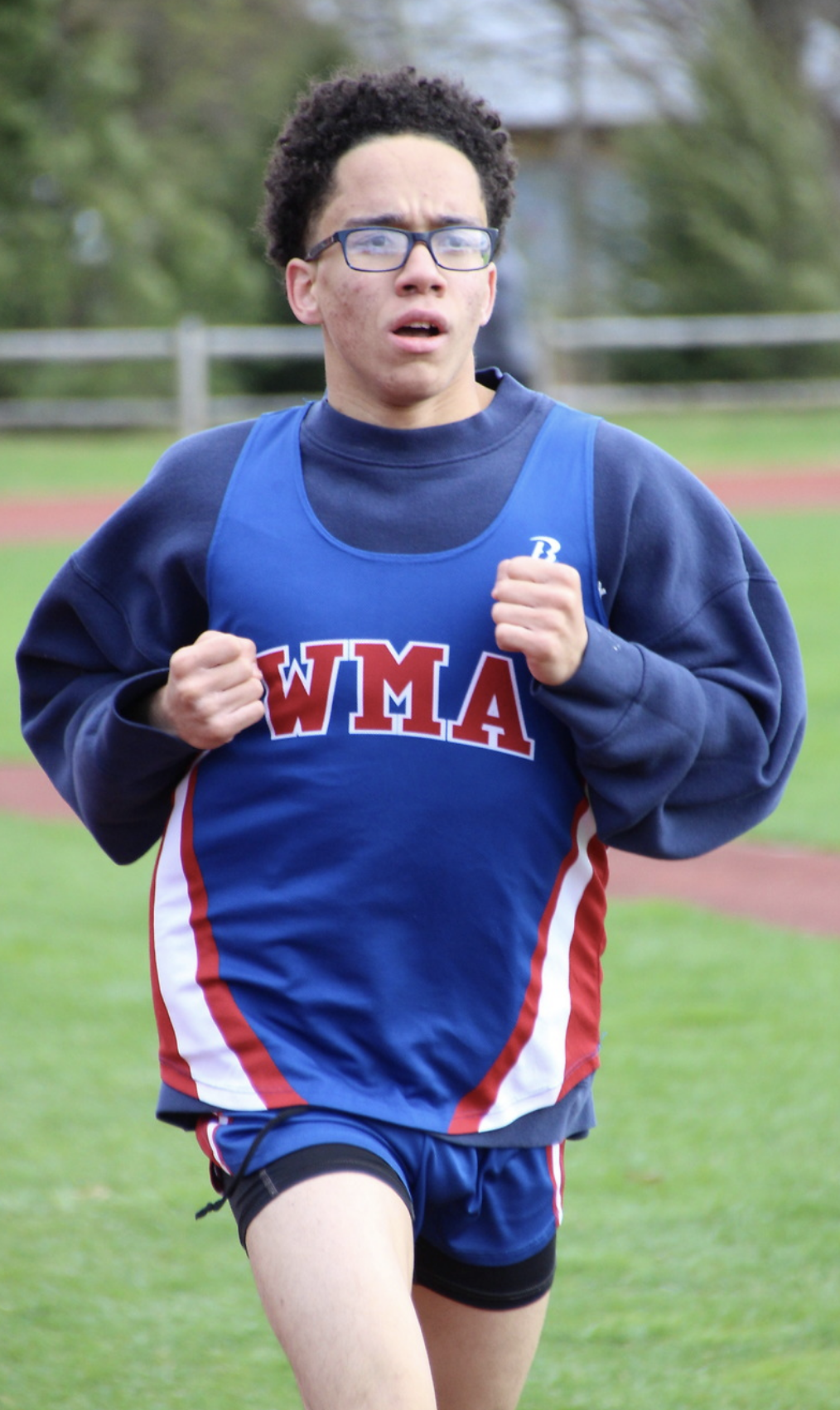 student running in track and field