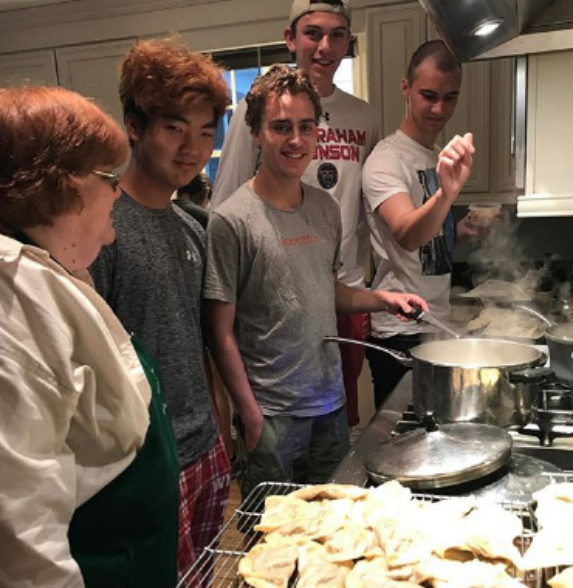 international students learning to cook