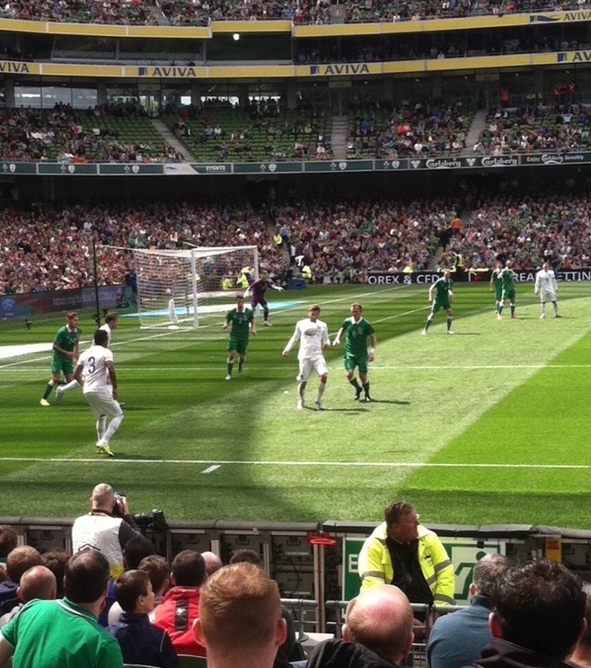 A close up view of a soccer friendly between Ireland and England.