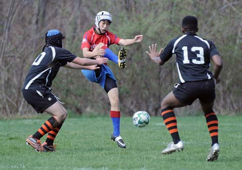 WMA rugby player kicks the ball
