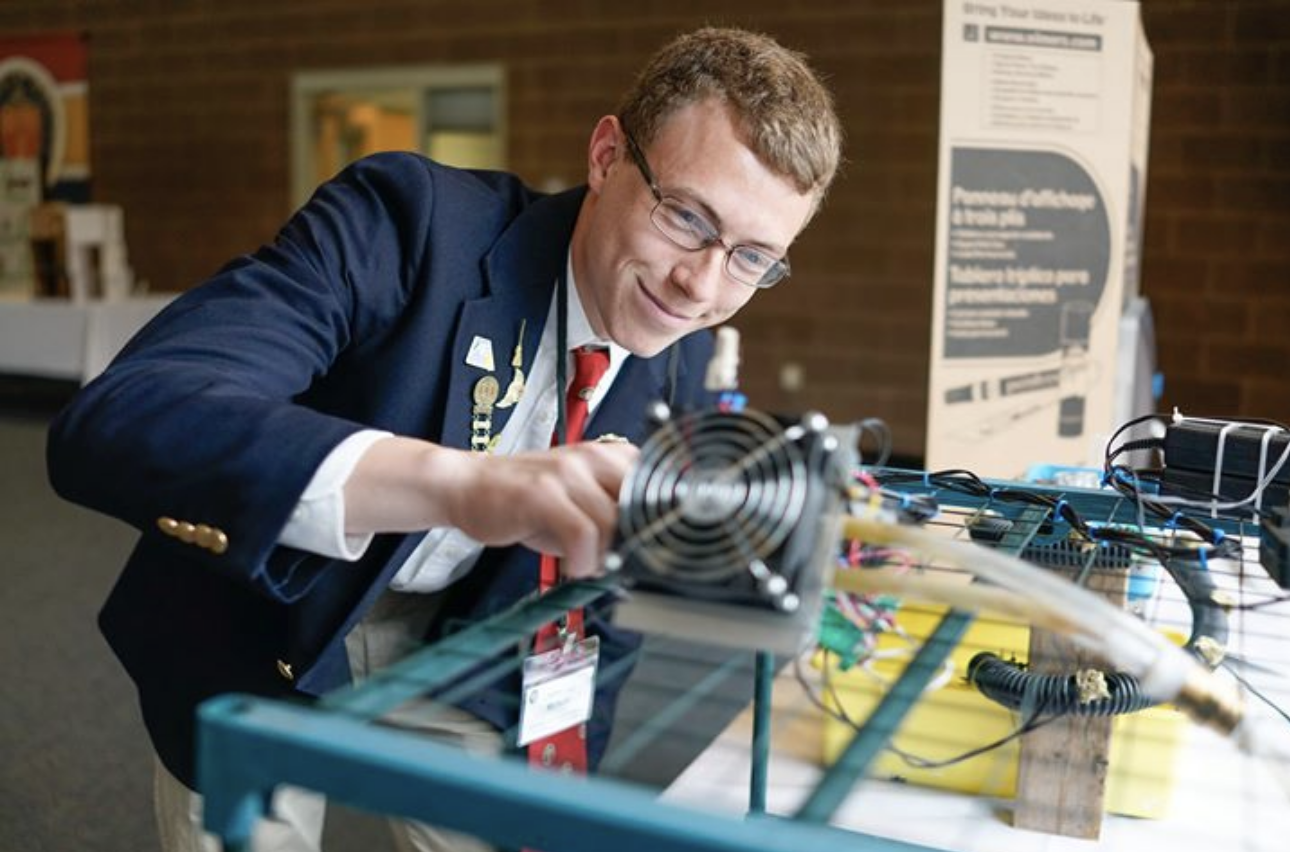 Student exhibiting science project at school expo