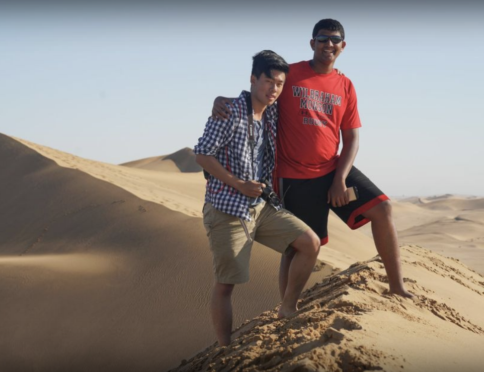 Students standing on sand dune during trip to Namibia