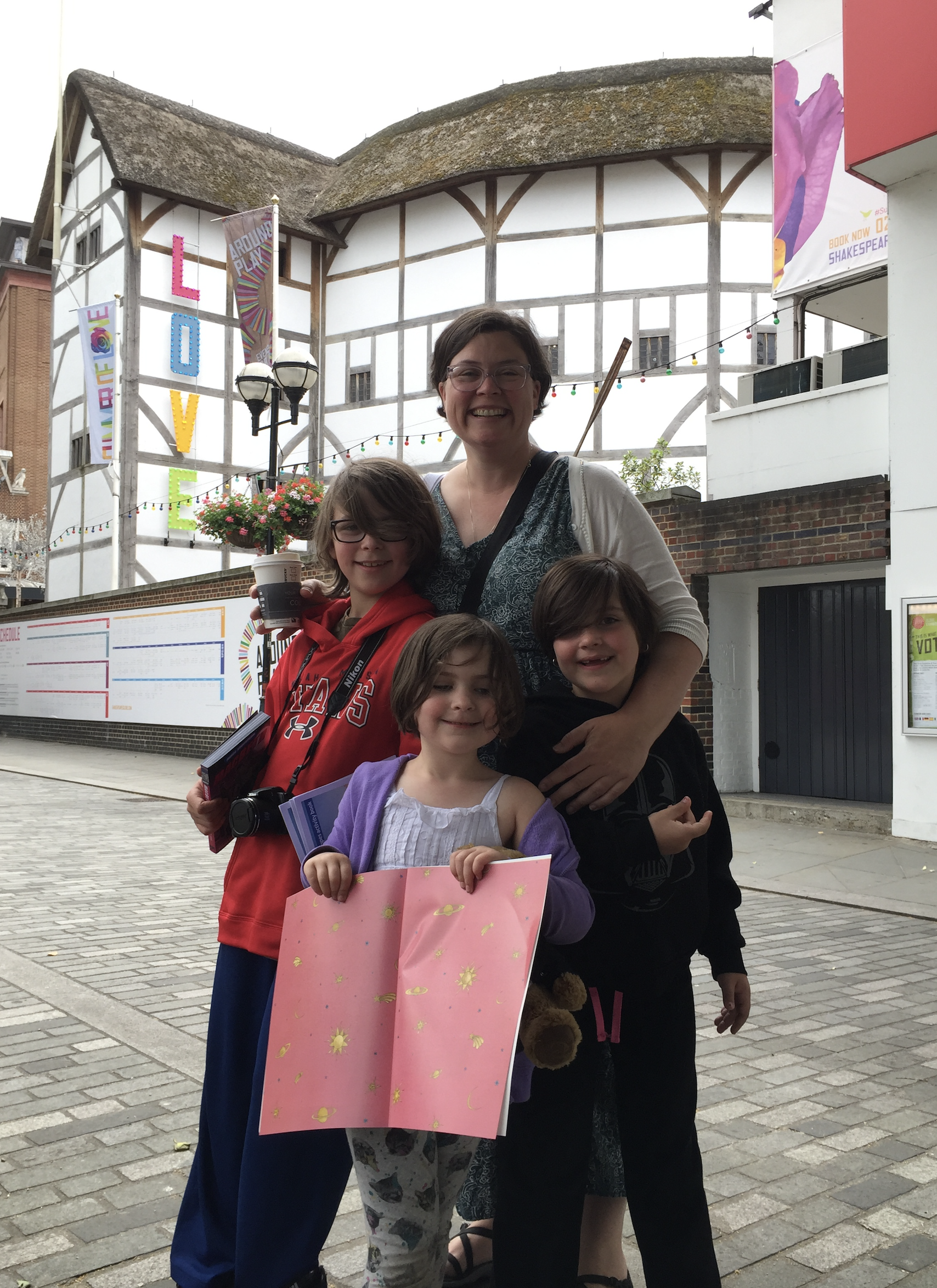 The Dziura Family stand in front of the Globe Theatre in London