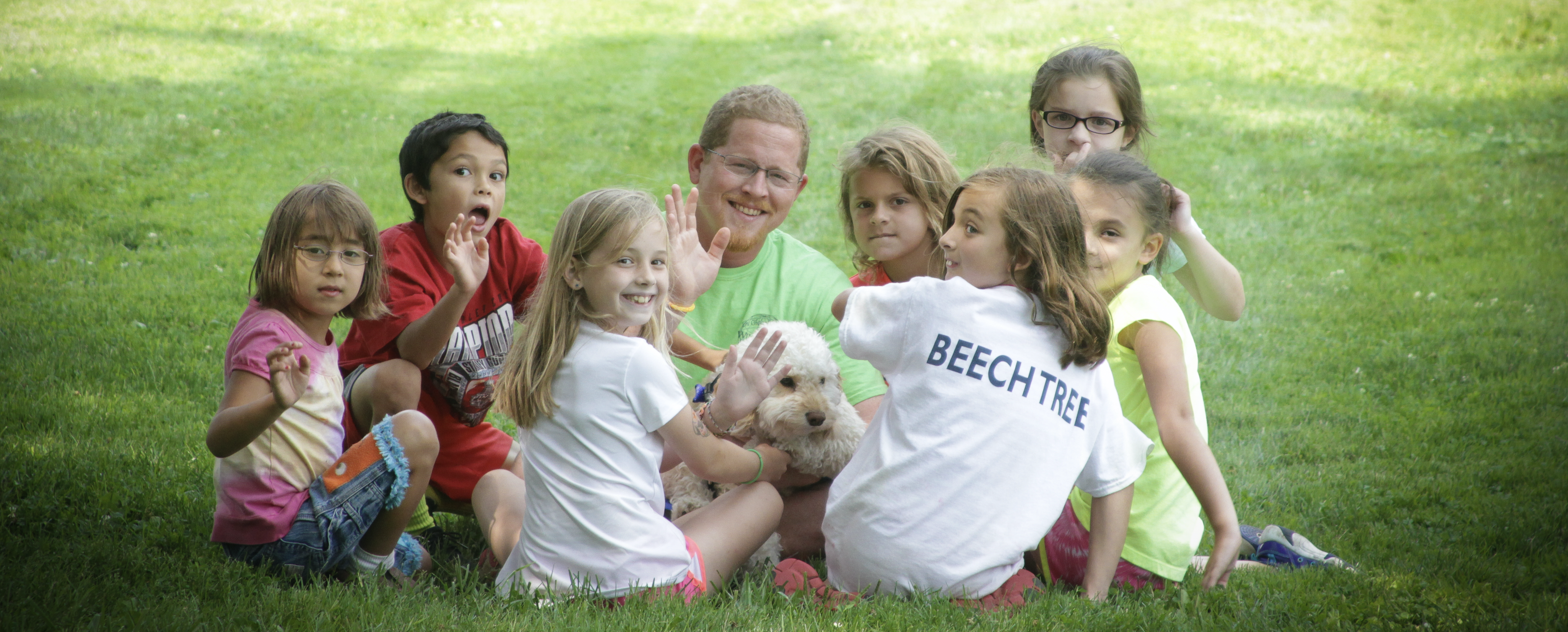 kids playing with puppy at summer camp